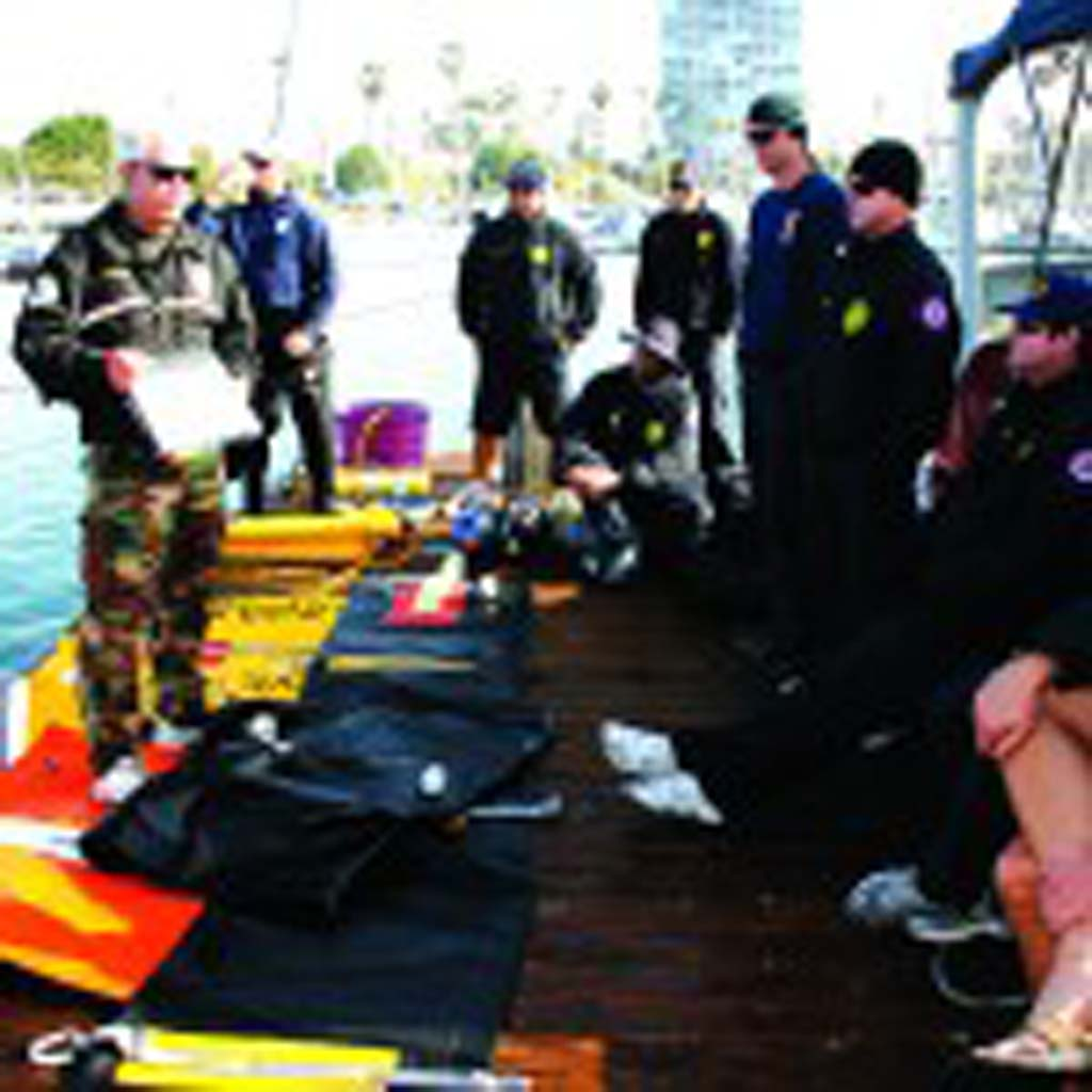 Oceanside Harbor Police officer Brian Sundberg, far left, leads training. Practice includes simulated body recovery and lifting a car out of the water. Photo by Promise Yee