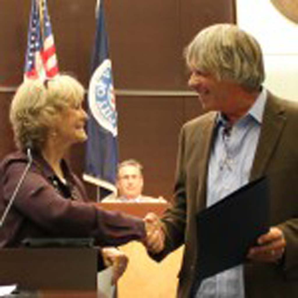 Vista Mayor Judy Ritter and Alta Vista Gardens CEO Kevin Morse shake hands after the reading of the Earth Day proclamation at the March 24, 2015 Council meeting. Photo by Gideon Marcus