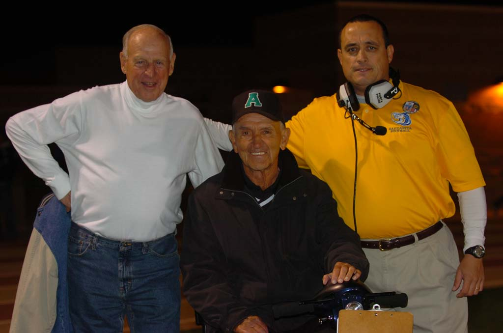 New Oceanside High School football coach David Rodriguez, far right, is taking over the helm from John Carroll, who retired after a long, successful run as coach of the Pirates. Rodriguez was formerly the coach at Sahuarita High School in Arizona. He's pictured with Herb Meyer, center, a successful football coach in his own right. Courtesy photo