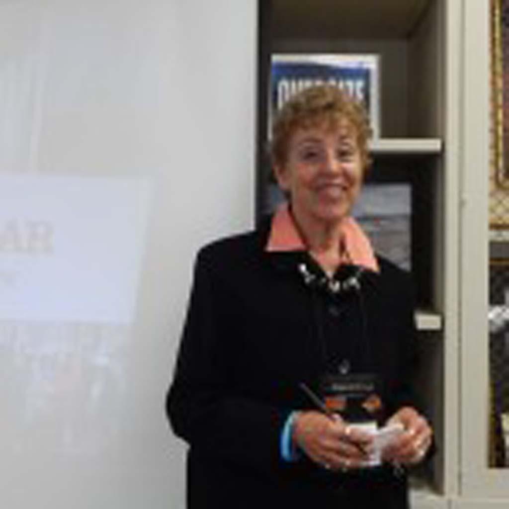 Jill Swaim, Road Scholar Volunteer ambassador, talks with visitors at the Rancho Santa Fe Library on the history and travel adventures of the unique organization. Photo by Christina Macone-Greene