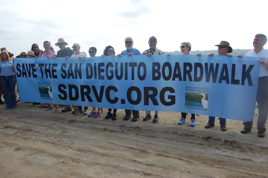 Holding a 20-foot banner created for a March 21 rally are representatives from Del Mar, Solana Beach, the 22nd District Agricultural Association, San Diego County and the San Dieguito River Valley Conservancy. Photo by Bianca Kaplanek