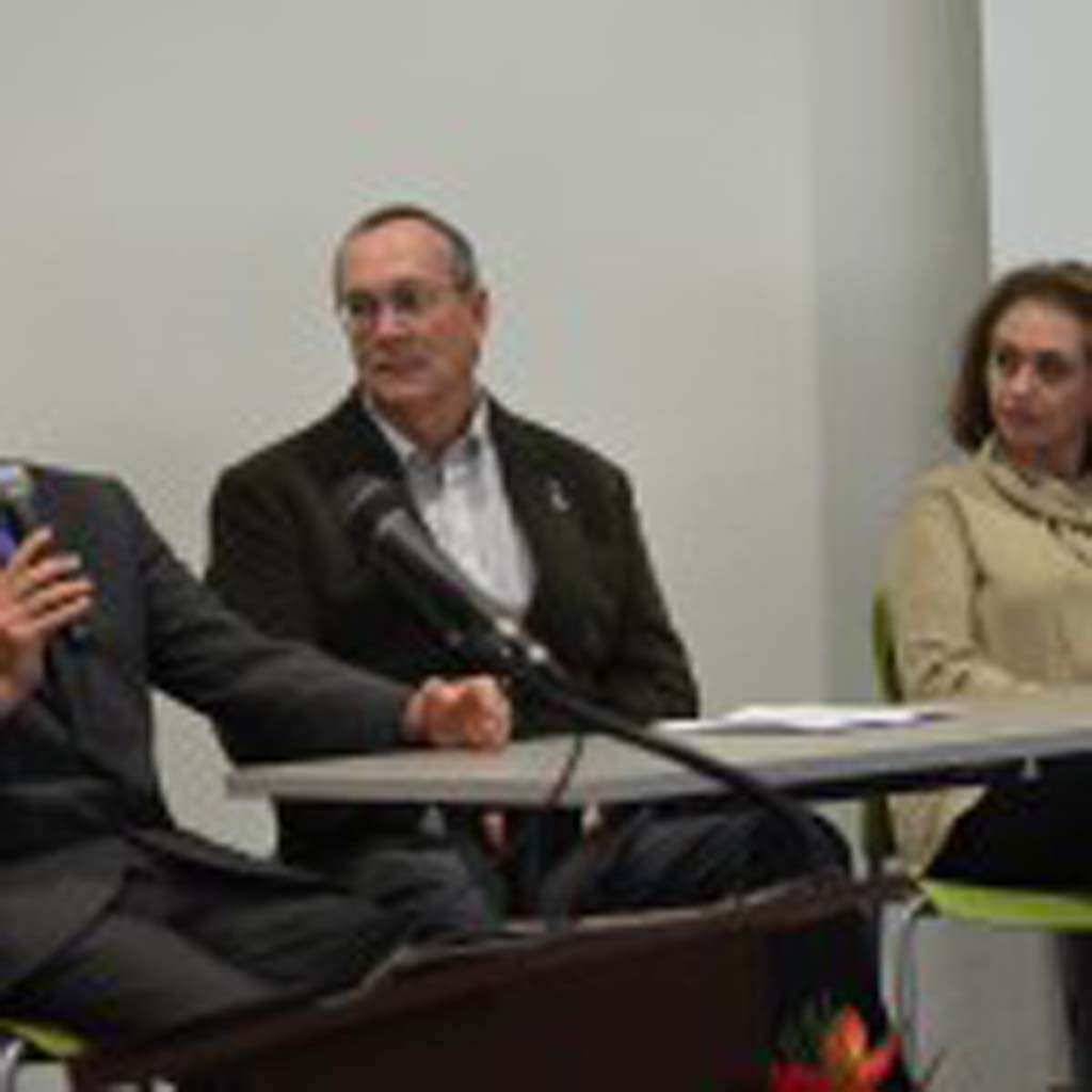 """From left, Raham Khodadadadeh, Larry Peifer and Mona Mahmoudi at a recent screening of the documentary """"To Light a Candle,"""" at the Vista Library. The documentary tells of the religious persecution and blocking access to higher education of people of the Bahá'í religion in Iran. Photo by Tony Cagala"""