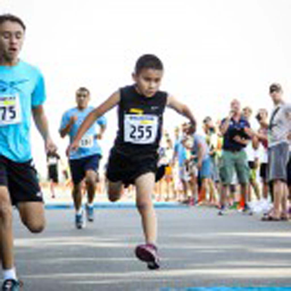 Jason Parra, 8, of Lakewood, Calif. (No. 255) may have set a new world record for his age group with his mile-time of 5:34. The Encinitas Mile race organizers are working to ratify the record to make it official. Photo by Mathew Davis/endurancesportsphotos.com