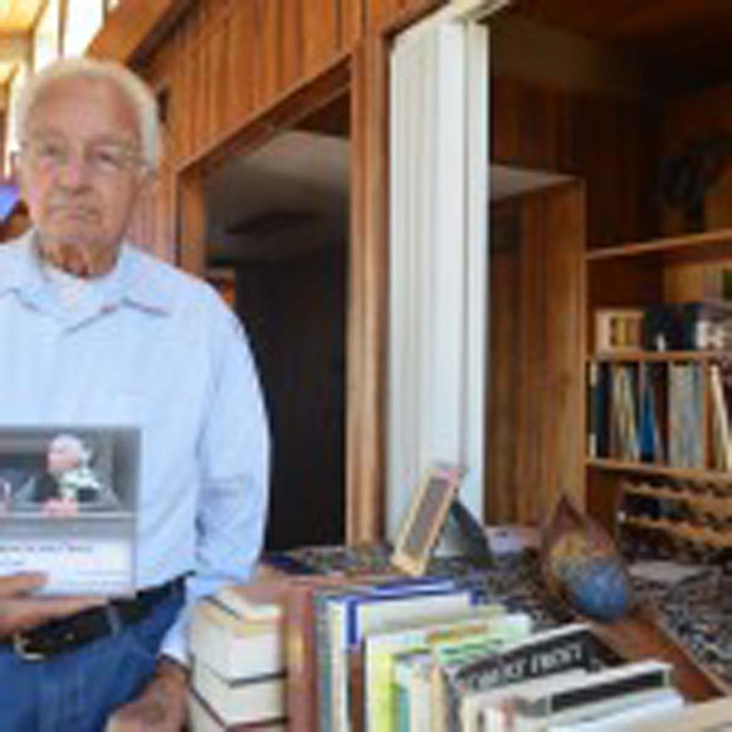 """Poet Tom Whayne, 90, with his first book of poems """"Of Strength and Grace: Elegy for Love"""" at his Cardiff home. Whayne will be reading selections from his book at Ducky Waddles at 7 p.m. April 15. Photo by Tony Cagala"""