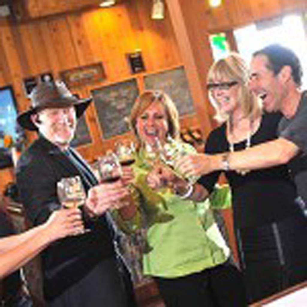 Falkner Winery owners Ray Falkner, far left, and Loretta Falkner, second from right, are in the middle of club member fun at their many events. Photo courtesy Falkner Winery