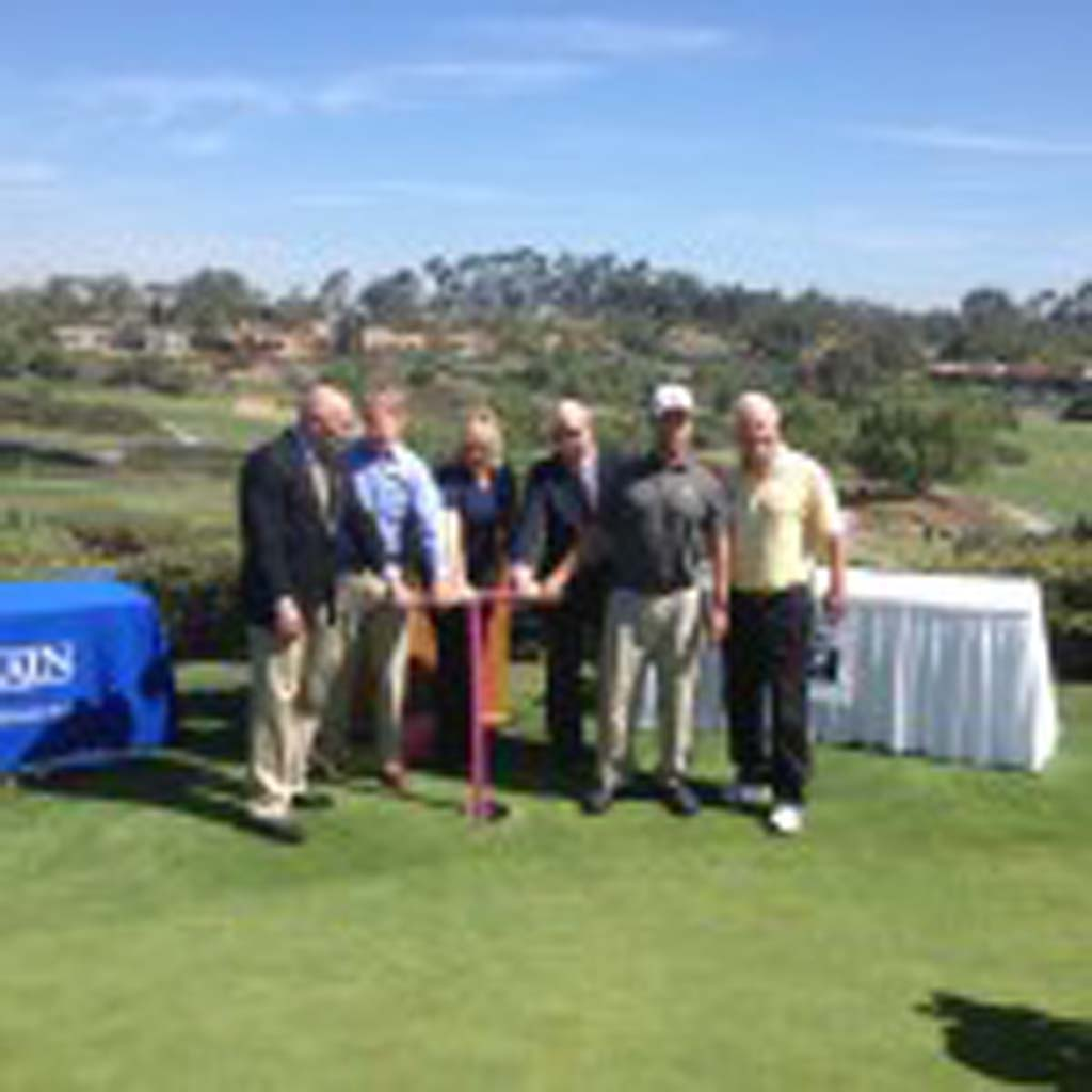 """Officials with the Olivenhain Municipal Water District """"turn the valve"""" on Thursday at The Farms Golf Club in Rancho Santa Fe. The valve-turning ceremony celebrates the completion of the course's conversion from potable to recycled water. Photo by Aaron Burgin"""