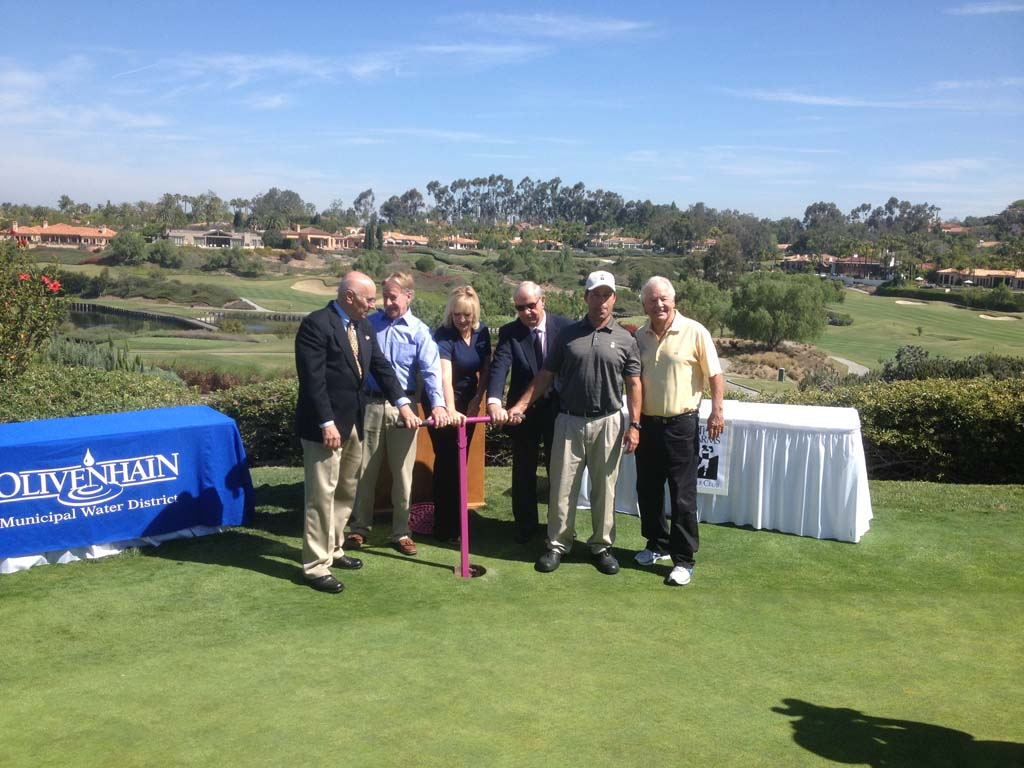 "Officials with the Olivenhain Municipal Water District ""turn the valve"" on Thursday at The Farms Golf Club in Rancho Santa Fe. The valve-turning ceremony celebrates the completion of the course's conversion from potable to recycled water. Photo by Aaron Burgin"