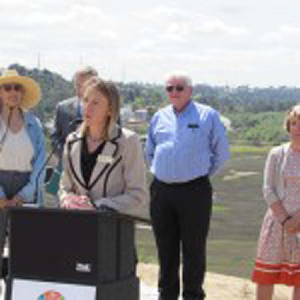 Encinitas Deputy Mayor Catherine Blakespear says protecting open space is important to growing urban areas. SANDAG and CalTrans announced the $6 million purchase of 50.5 acres in the Batiquitos Lagoon on Tuesday. Photo by Ellen Wright