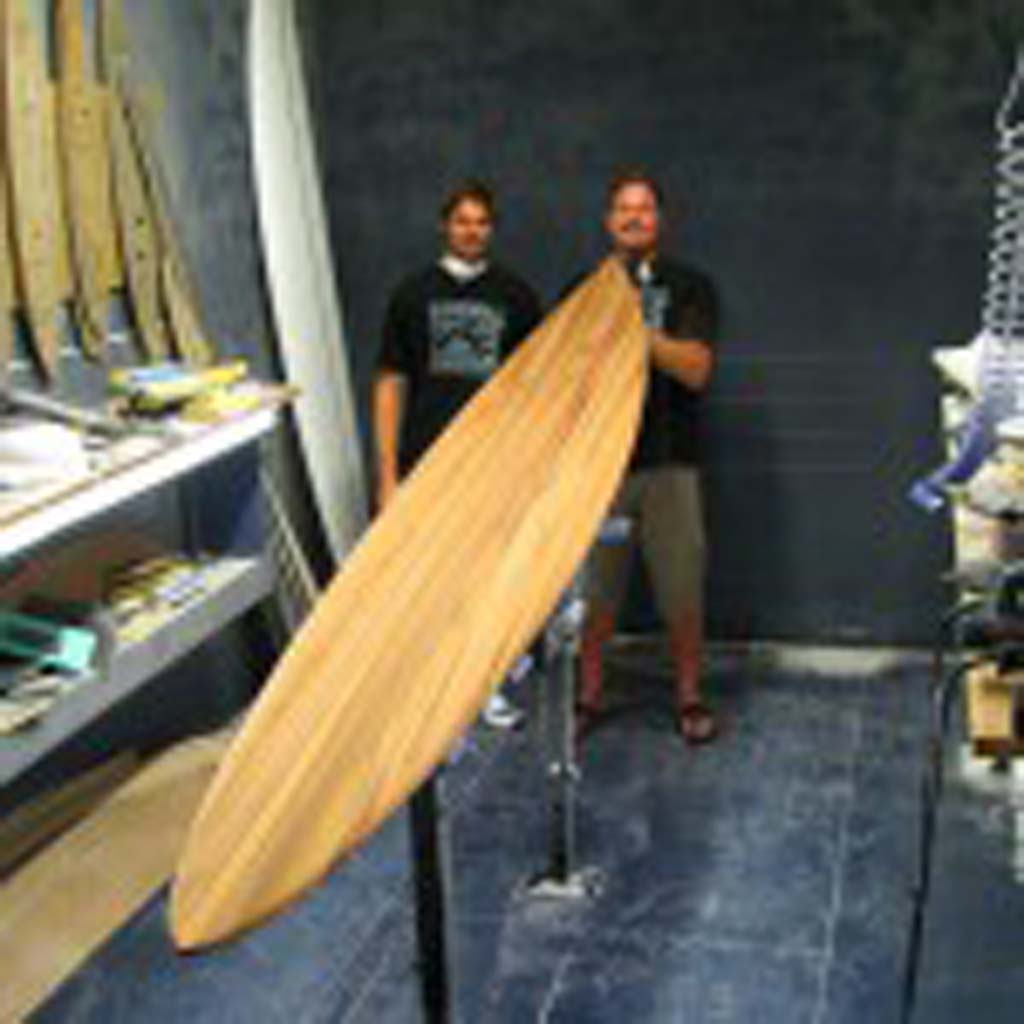 Surfing icon Rusty Preisendorfer, right, is this year's honoree at The Boardroom surf tradeshow. He and his son Clint, left, will serve as judges in the Icons of Foam Tribute shape off. Courtesy photo