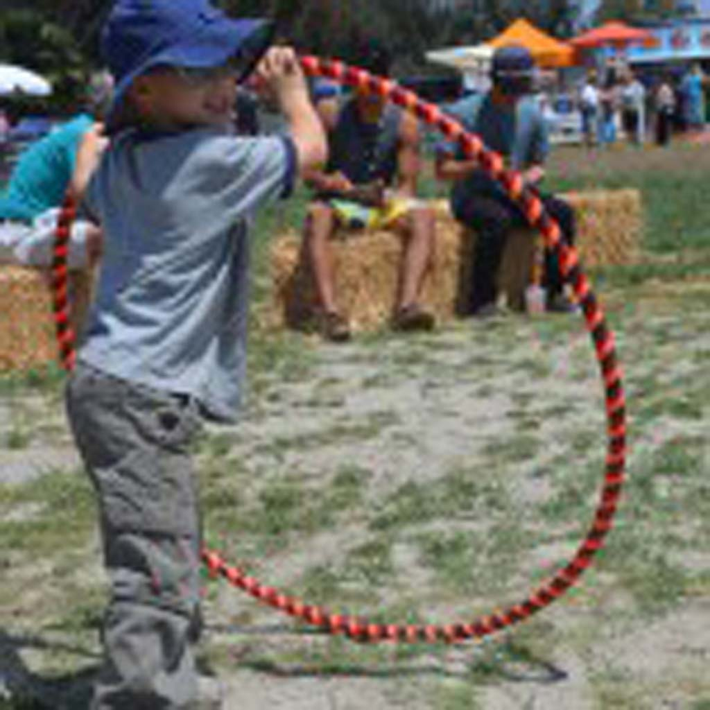 Dane Benich finds a new way to use a hula-hoop at the EcoFest in Encinitas on Sunday. Photo by Tony Cagala