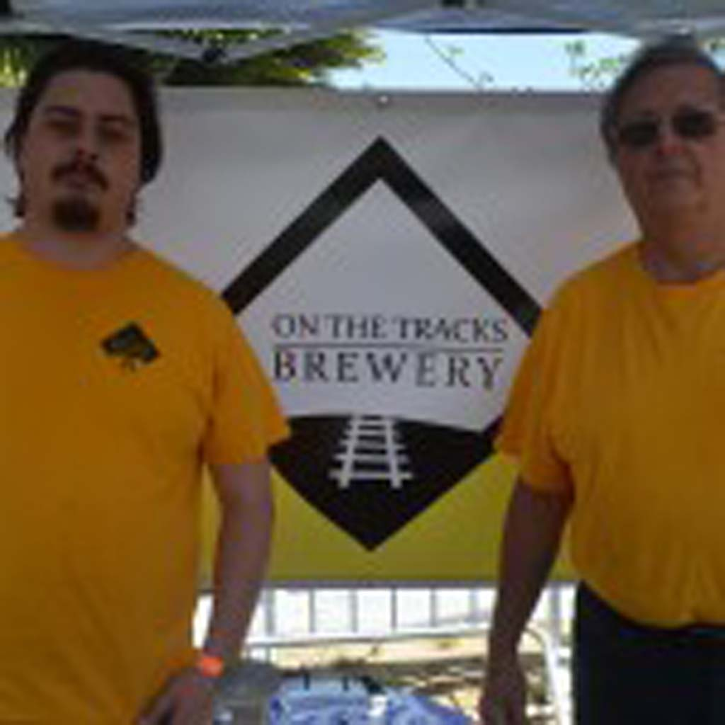 Preston Crisp, left, and John Davison of Carlsbad's Off the Track Brewery at the beer garden at the EcoFest in Encinitas. Photo by Tony Cagala
