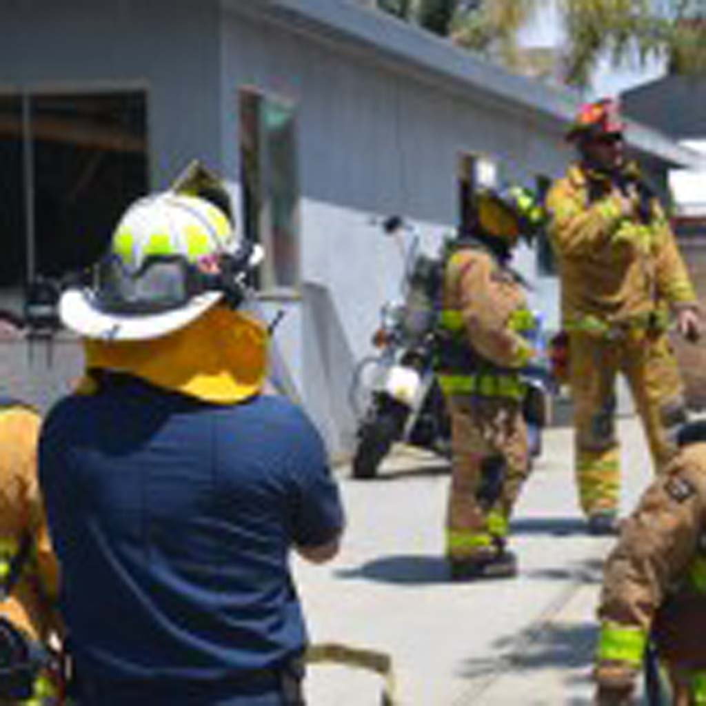 The body of an unidentified man is found in an Encinitas home Friday morning. Fire crews received a call to the scene for a gas leak inside a structure with a possible victim. Photo by Tony Cagala