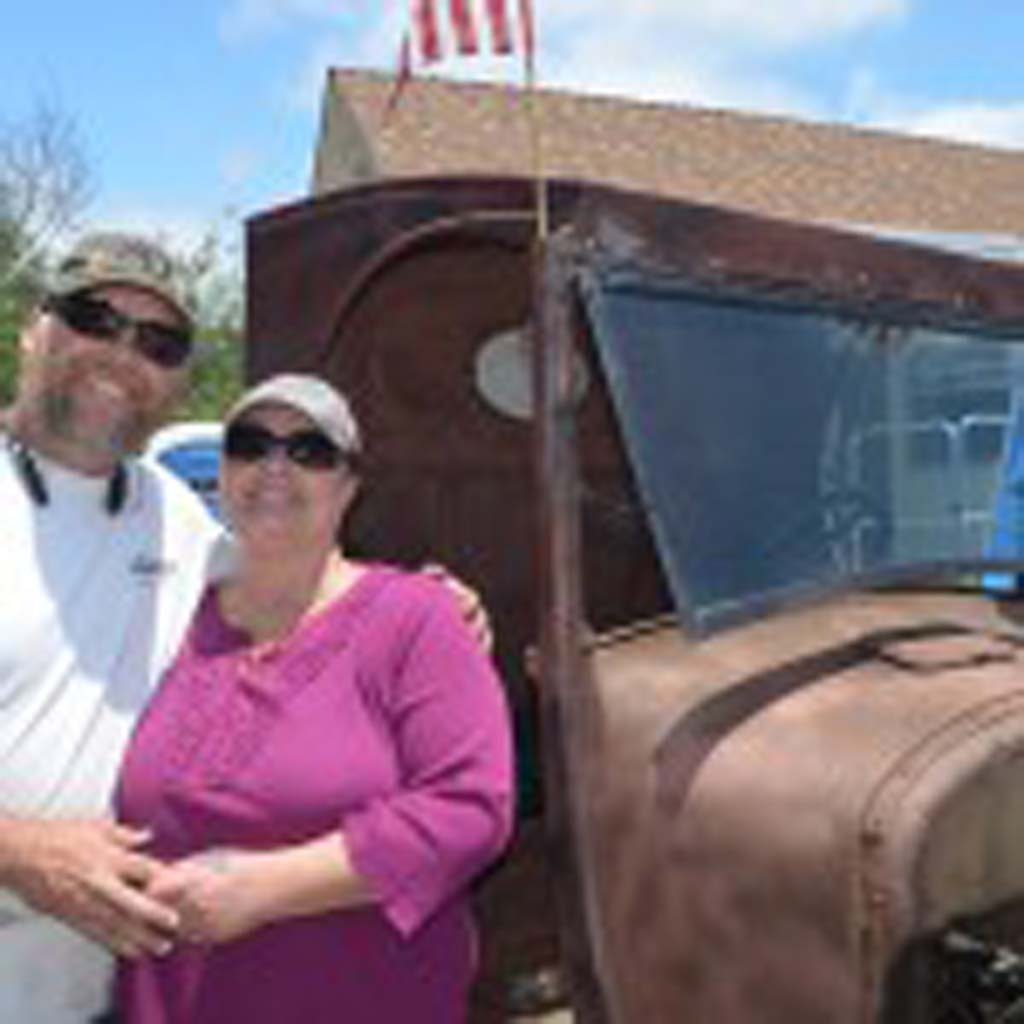 Phil Ewing and his wife Kimba Ewing pose in front of their 1926 Ford Model-T pick up truck. Photo by Tony Cagala