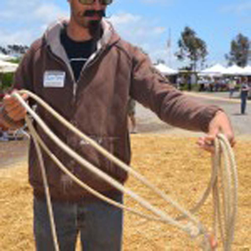 Justin Teten gathers up a lasso at the San Dieguito Heritage Museum. Photo by Tony Cagala