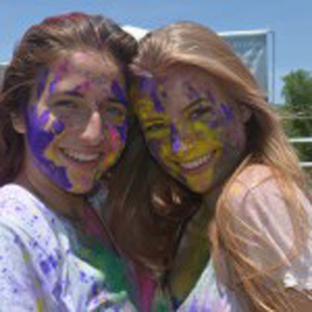 Morgan Lypps, left, and Kambremm Johnson after throwing their colors to the wind. Photo by Tony Cagala