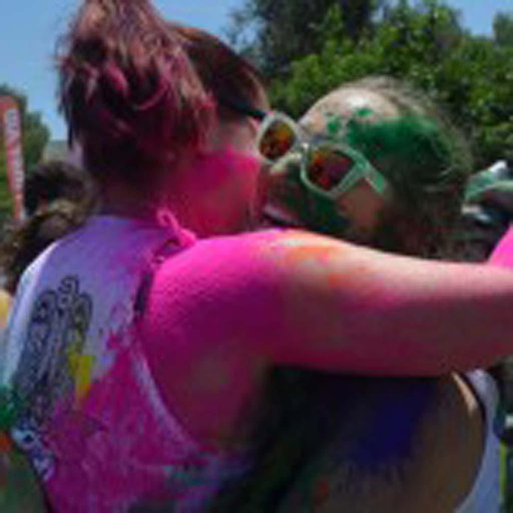 Hugging is part of the traditional Holi Festival of Color celebrated in India. The festival helps close social gaps and to renew relationships, some through hugs. Photo by Tony Cagala