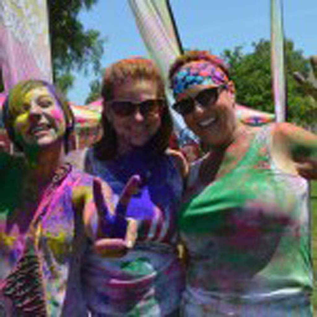 From left: Sophia Rideout, Melissa Nickerson and Christine Rideout get colorful. Photo by Tony Cagala