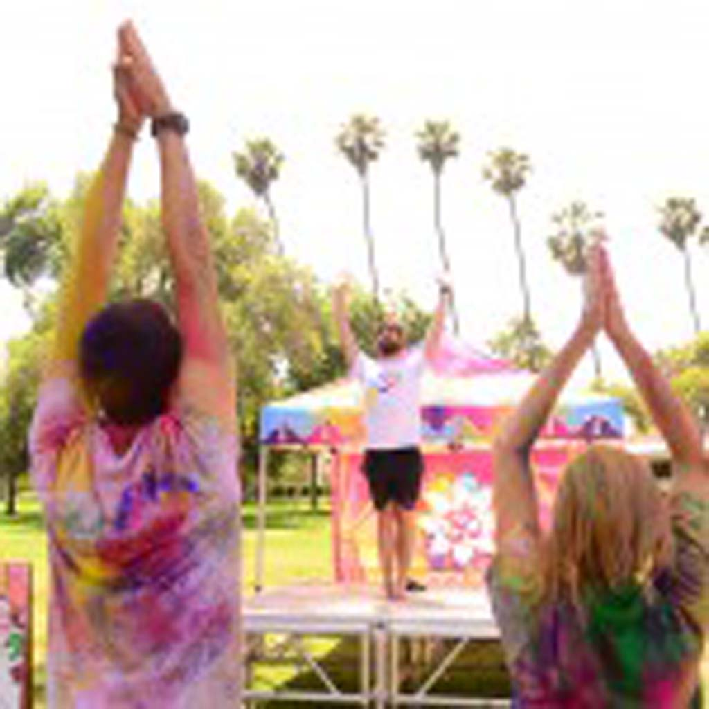 People attending the Festival of Colors also were able to take some free yoga classes. Photo by Tony Cagala