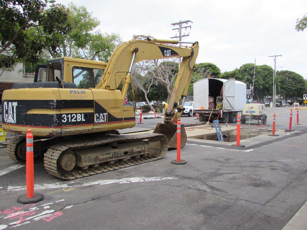 Construction crews are working on improving the storm drainage along Grand Avenue. The project should be done by October. Photo by Ellen Wright