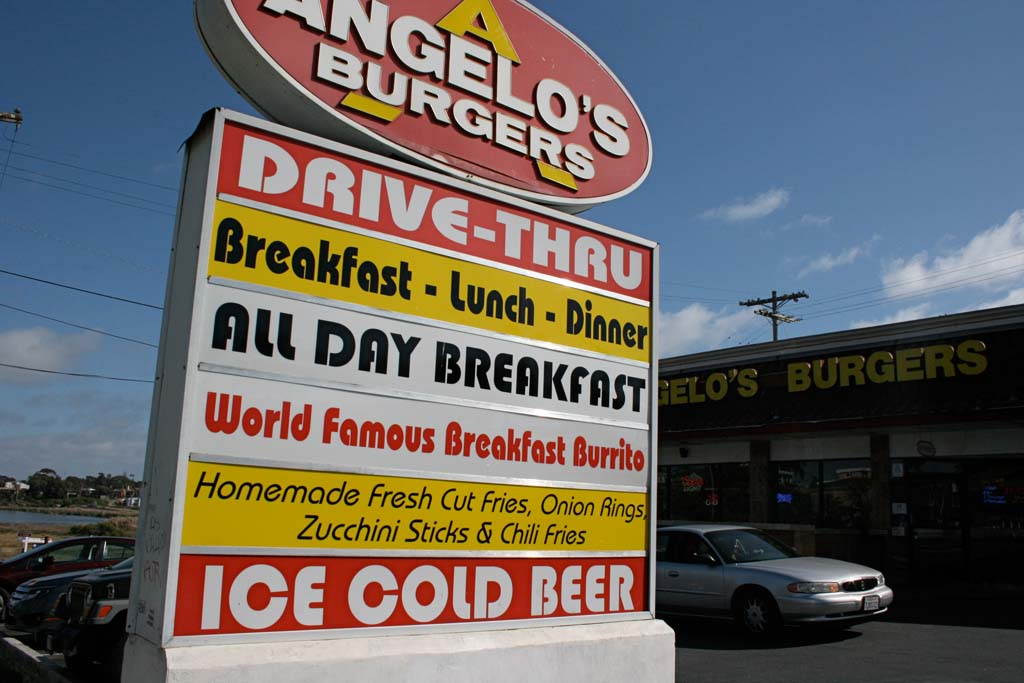 Angelo's Burgers' three locations will be the only Oceanside restaurants with drive thru service allowed to sell beer and wine. The restaurants were grandfathered in when new rules passed. Photo by Promise Yee