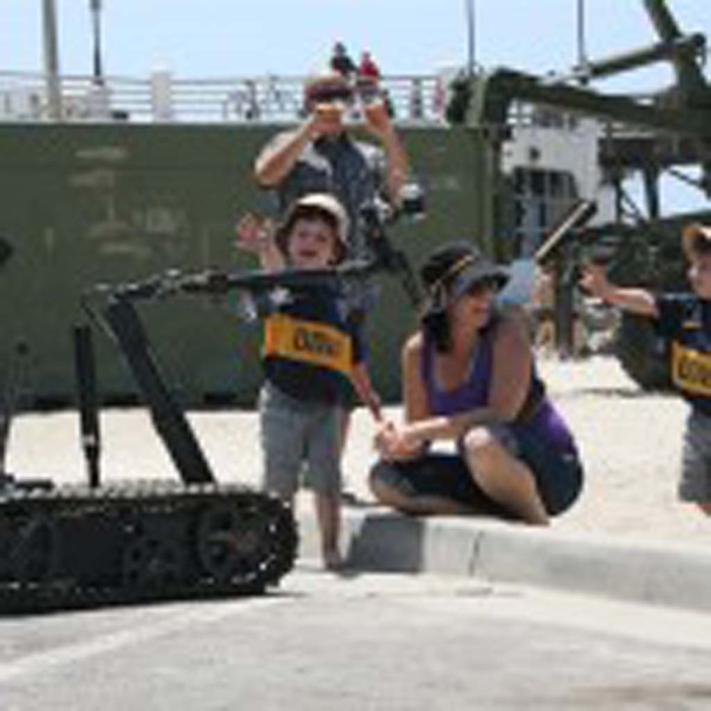 The Marine explosive ordinance team robot is a crowd pleaser at the Operation Appreciation celebration. There is also a display of historical military vehicles, food and carnival rides. Oceanside says thank you to active duty military with a day of fun May 16. File photo by Promise Yee