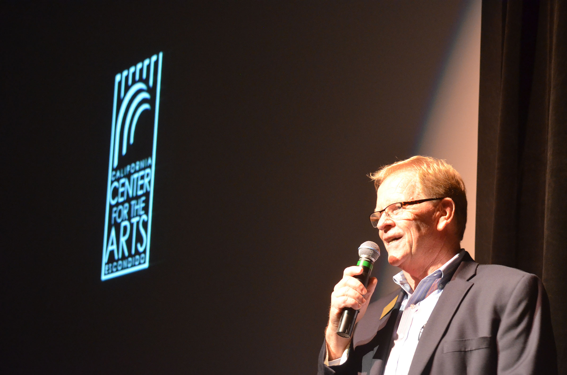 Jerry Van Leeuwen, executive director of the California Center for the Arts, Escondido announces the 2015-16 line up to members during a preview party on June 11. Photo by Tony Cagala
