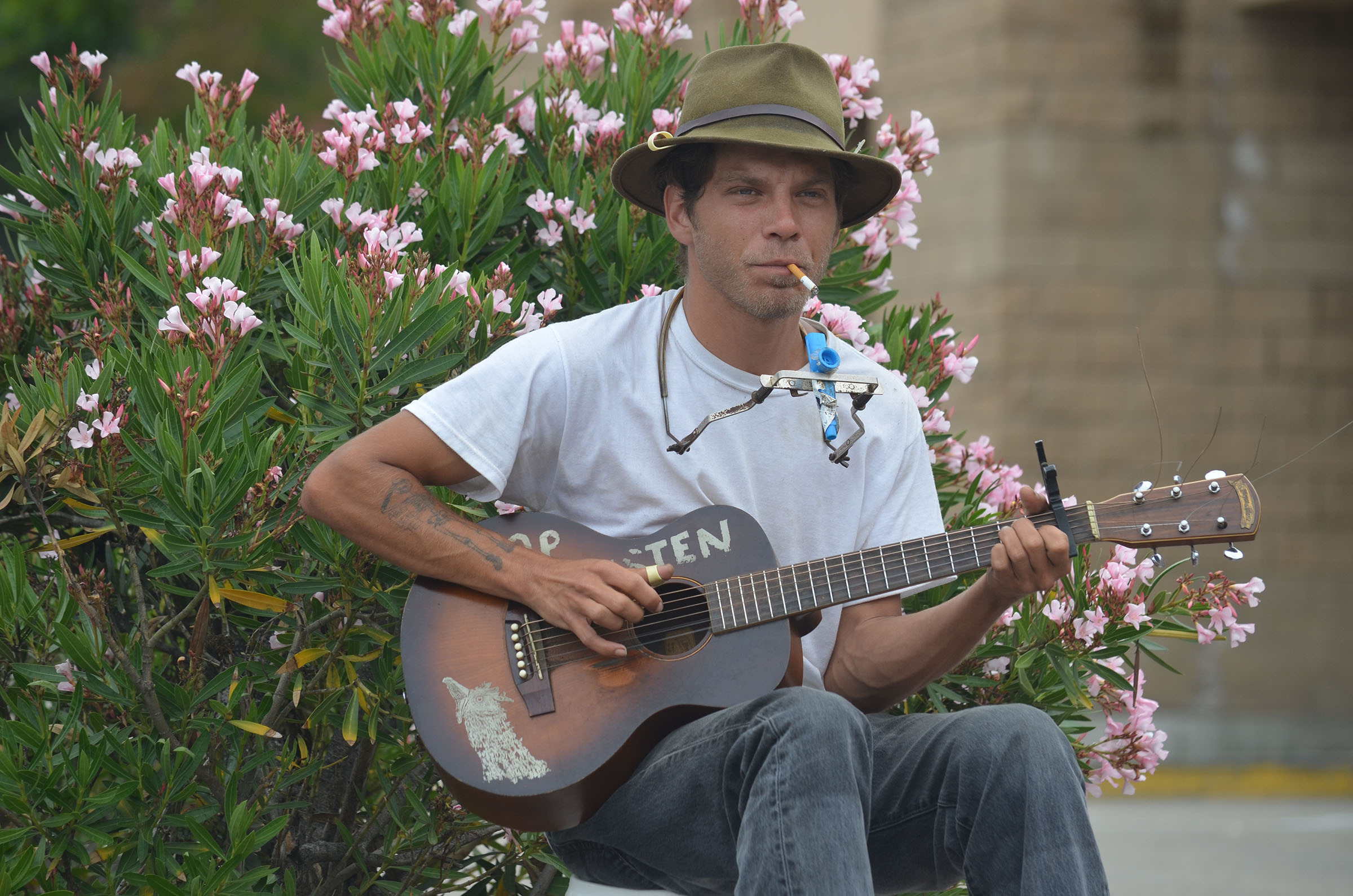 Matt Rivers plays some jug band music in the parking lot of a shopping center in Escondido on Saturday. Rivers, who grew up in Escondido, has been living the lifestyle of troubadour for at least six years now. Photo by Tony Cagala
