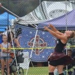 A competitor of the Scottish Highland Games sets a hammer flying in the hammer toss event. Photo by Tony Cagala