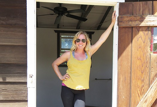 Renée Miller strikes a pose in the doorway of her vintage studio, now in its new location at Sunshine Gardens in Encinitas. Photo by Kay Colvin