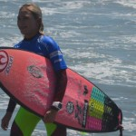Alyssa Spencer, 12, is all smiles after competing against professional surfers, making it into the money round of the Paul Mitchell Supergirl Pro last weekend in Oceanside. Photo by Tony Cagala