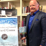 Local author Edward Cozza makes use of the counties libraries, including the Rancho Santa Fe branch, to complete two of his novels. He spoke to an audience during a local author showcase and book signing recently. Photo by Christina Macone-Greene