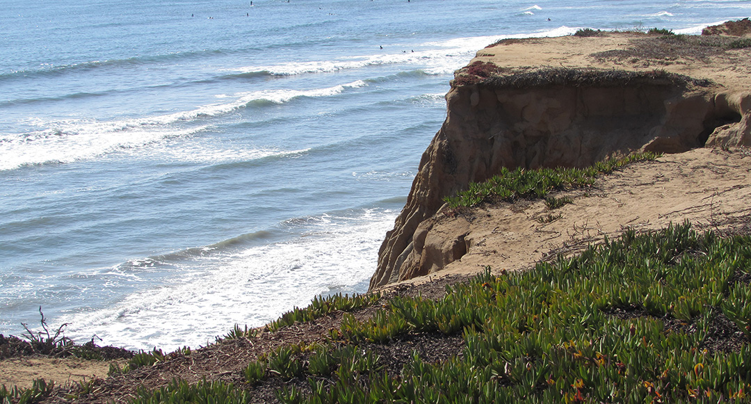 In the early hours of Tuesday morning, two girls were pushed off the cliff at Terramar Beach in Carlsbad. One sustained minor injuries and was taken to Scripps Medical Center in La Jolla. Photo by Ellen Wright
