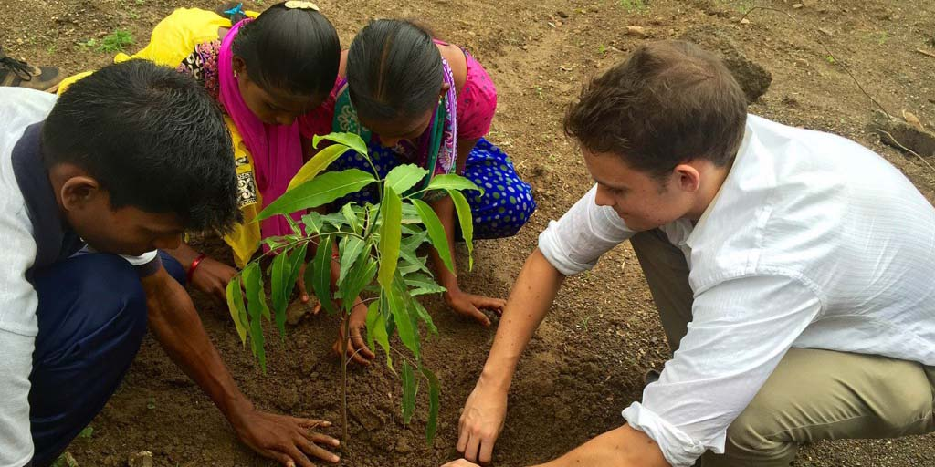 As in intern in India, Del Mar resident Kyle Joyner helps students plant a tree at their school in celebration of the high scores they earned on their secondary school board exams. Courtesy photo