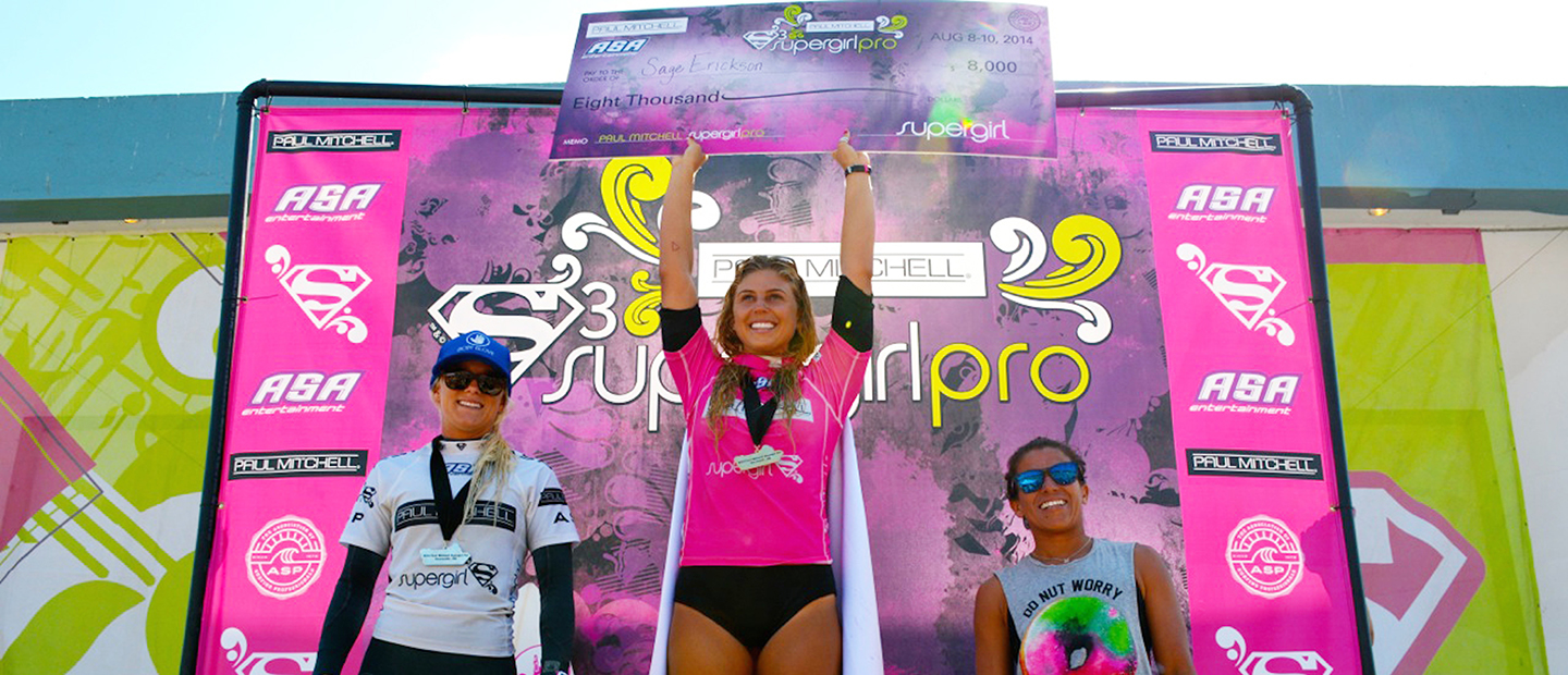Surfer Sage Erickson, center, looks to defend her Supergirl Pro crown this weekend in Oceanside. She won the contest last year in front of family and friends. Photo by John Alvarea
