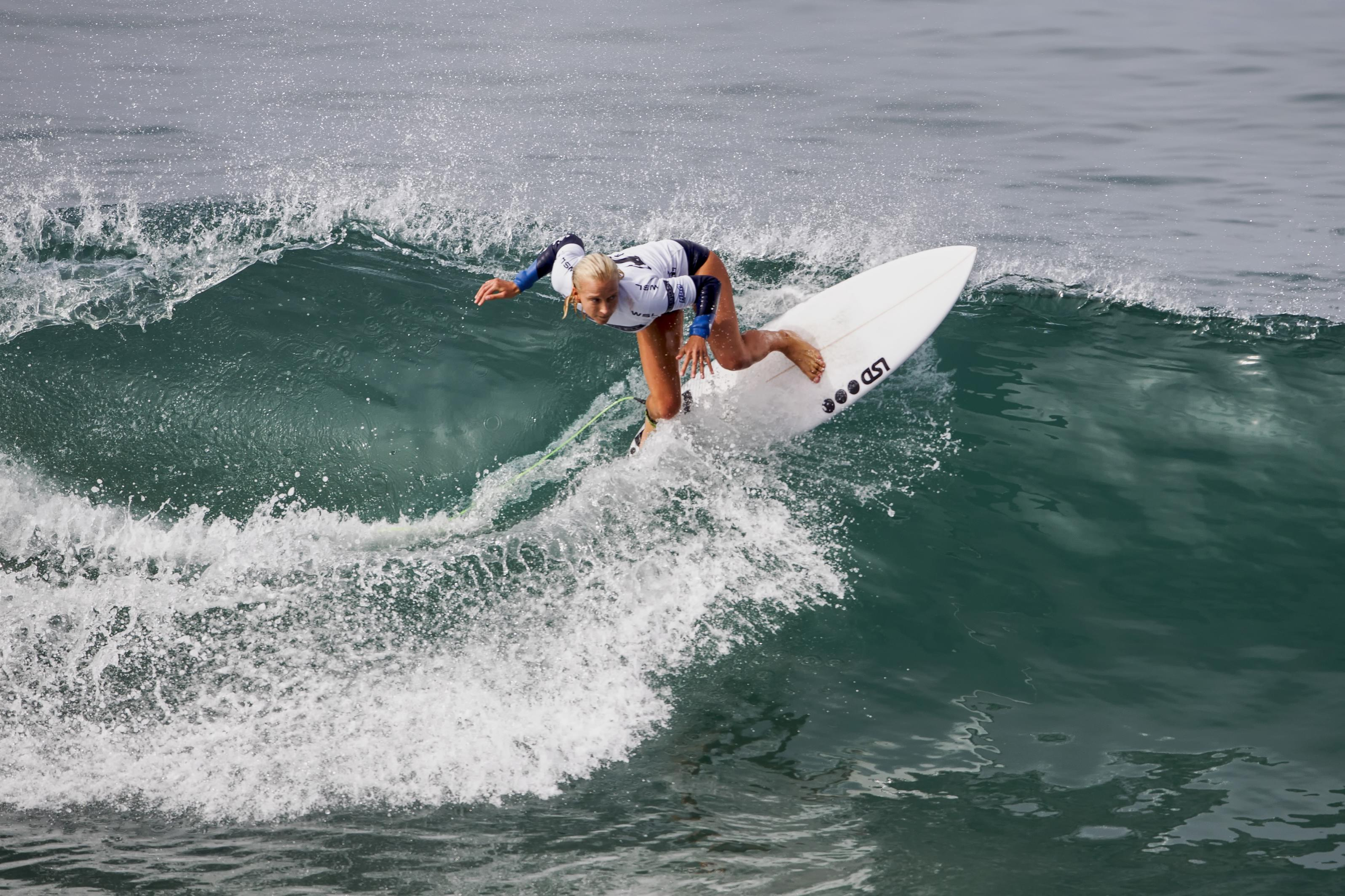 Georgia Fish competes during Round 4, Heat 1 of the Paul Mitchell Supergirl Pro held in fun 2 - 3 foot surf on Saturday in Oceanside. Photo by Bill Reilly
