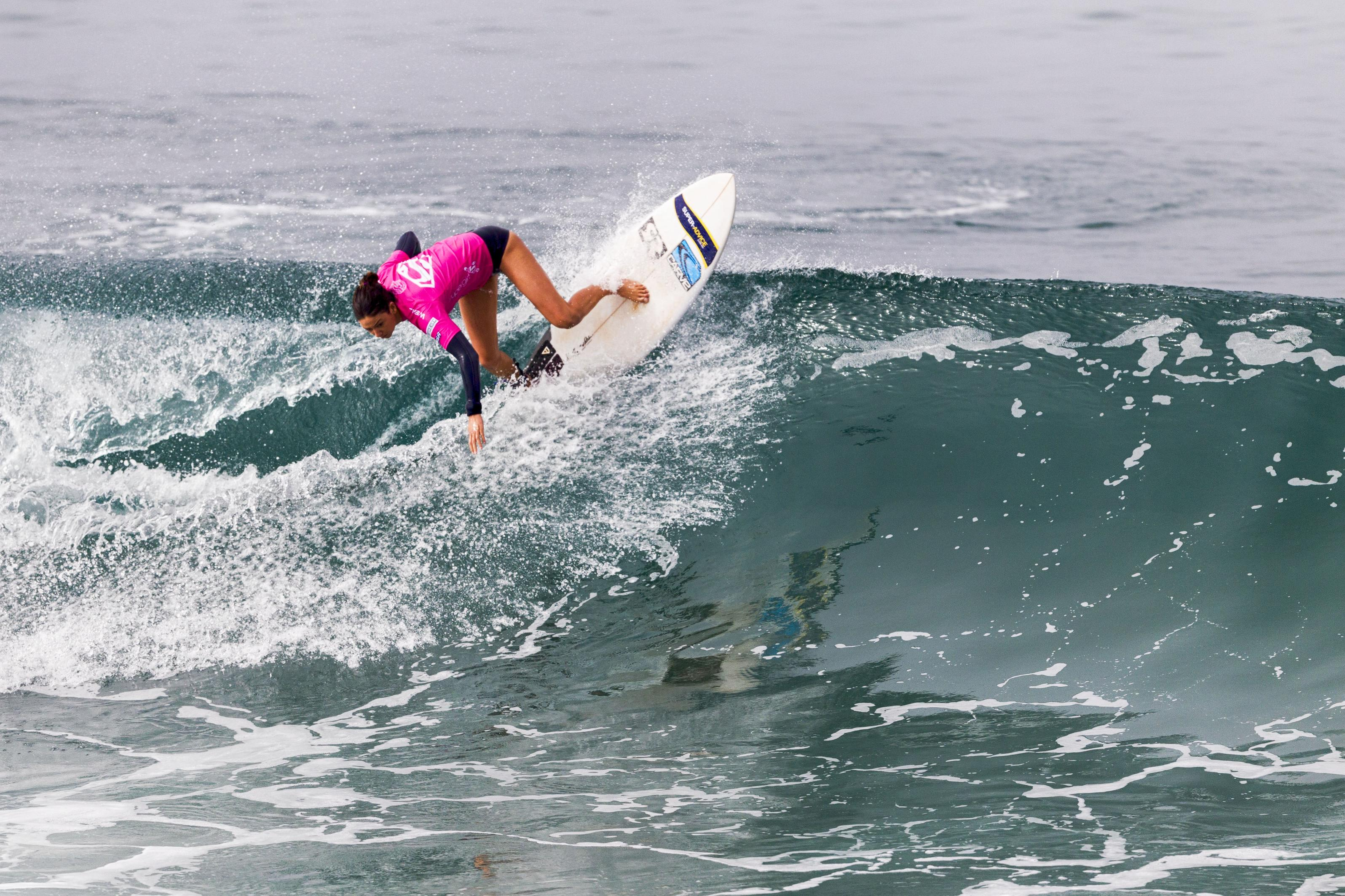 Mikaela Greene of Australia surfs in Round 3, Heat 11 during the Paul Mitchell Supergirl Pro in Oceanside. Photo by Bill Reilly