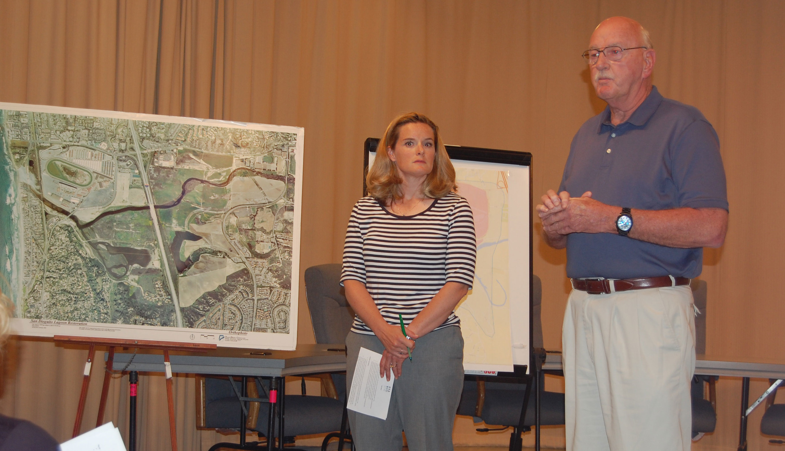 Julie Coleman, with Kaaboo producer The Madison Companies, and Pat Kerins, chief of security for the Del Mar Fairgrounds, address the concerns of Del Mar residents during an Aug. 3 meeting to discuss impacts from the three-day event scheduled to begin Sept. 18 at the fairgrounds Photo by Bianca Kaplanek