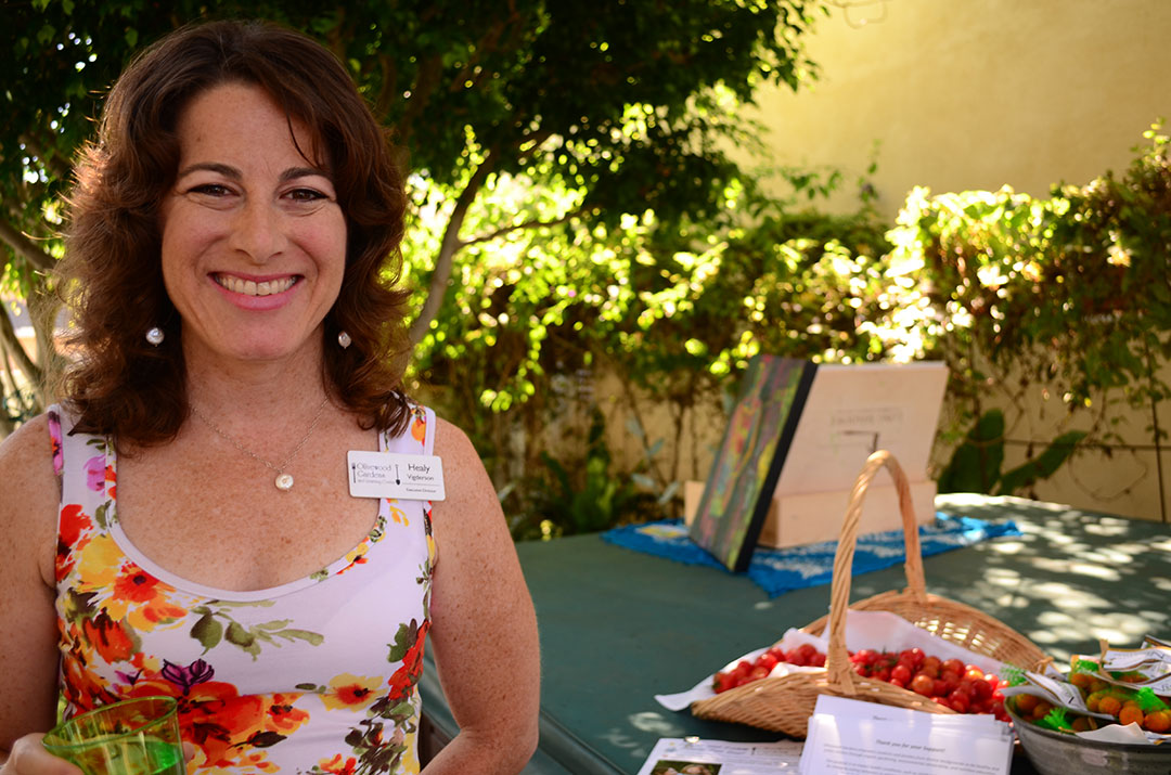 Healy Vigderson, executive director of Olivewood Garden and Learning Center, attends the benefit at the Encinitas home of Larry and Jolee Pink. Photos by Tony Cagala