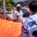 Tony Wilson collects signatures from Chargers fans outside of Chargers Park on Saturday. Photo by Tony Cagala