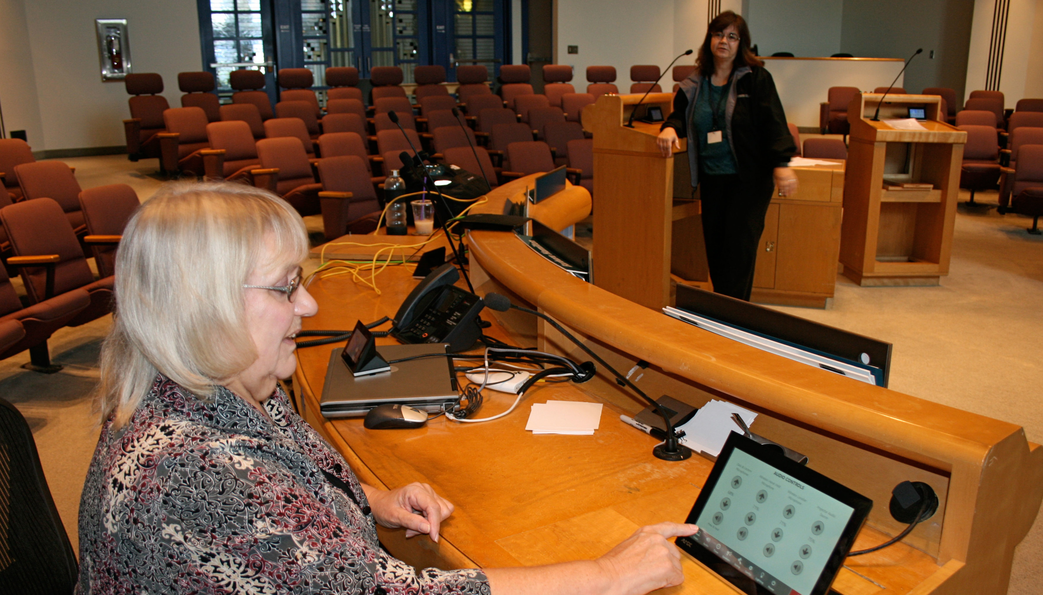Holly Trobaugh, assistant city clerk, left, and Yukari Brown, city IT division manager, test the new system on Tuesday. City Council put it to use on Wednesday. Photo by Promise Yee