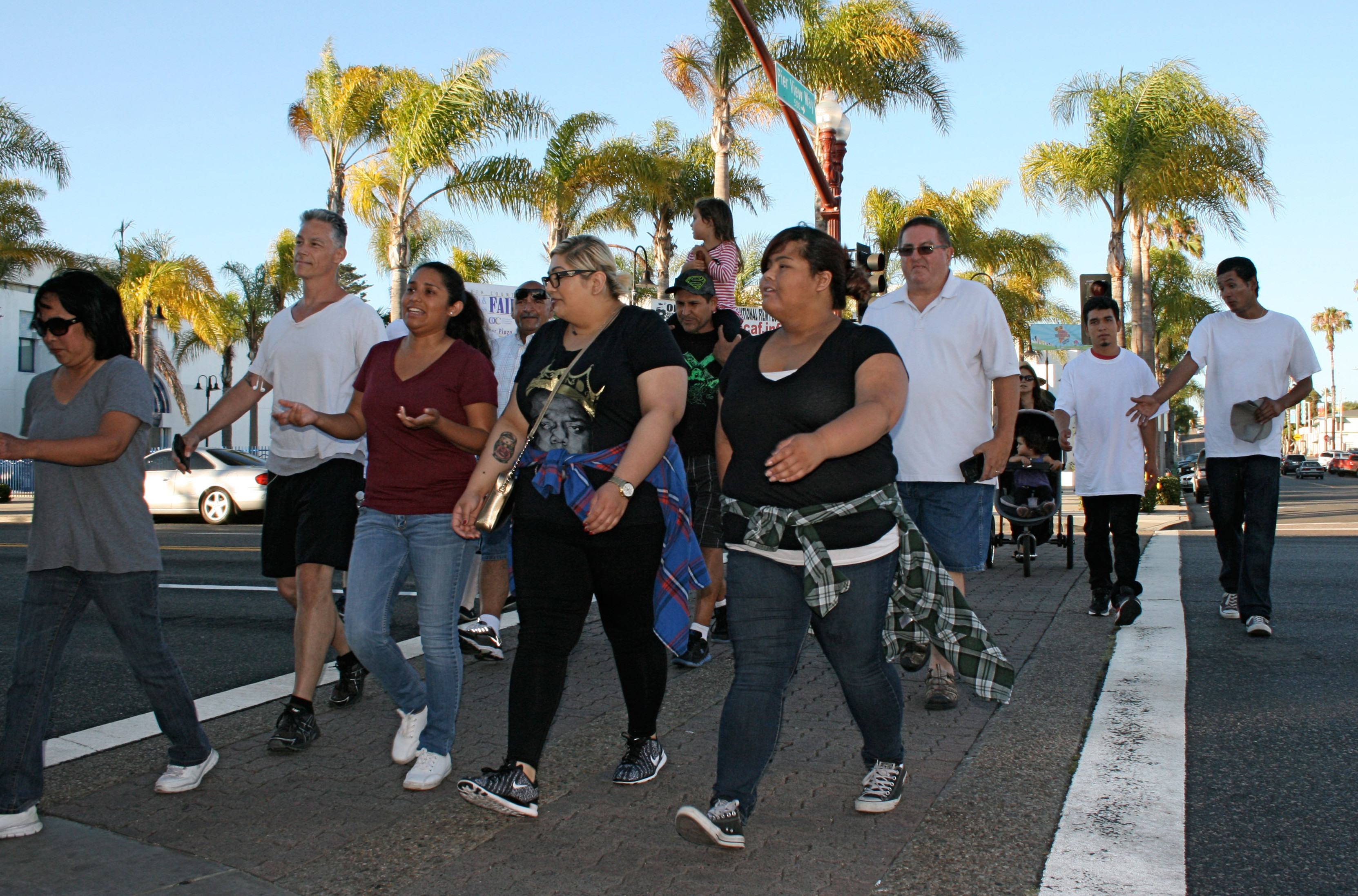 Dozens of people take part in a peace walk during National Night Out. The annual walk went down Pier View Way to the amphitheater. Photo by Promise Yee