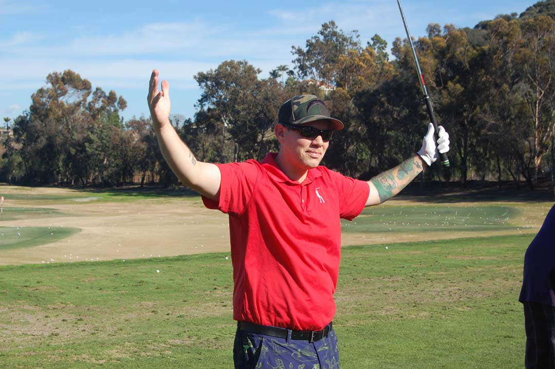 Army Staff Sgt. Charles Vasquez celebrates after sinking a hole-in-one. Photo by Bianca Kaplanek