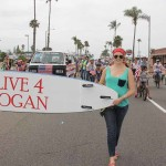 Right, Bess Singleton, co-organizer of the Live 4 Logan bike coalition, carries the group's entry banner. The Live 4 Logan bike coalition was formed last November. Photo by Promise Yee