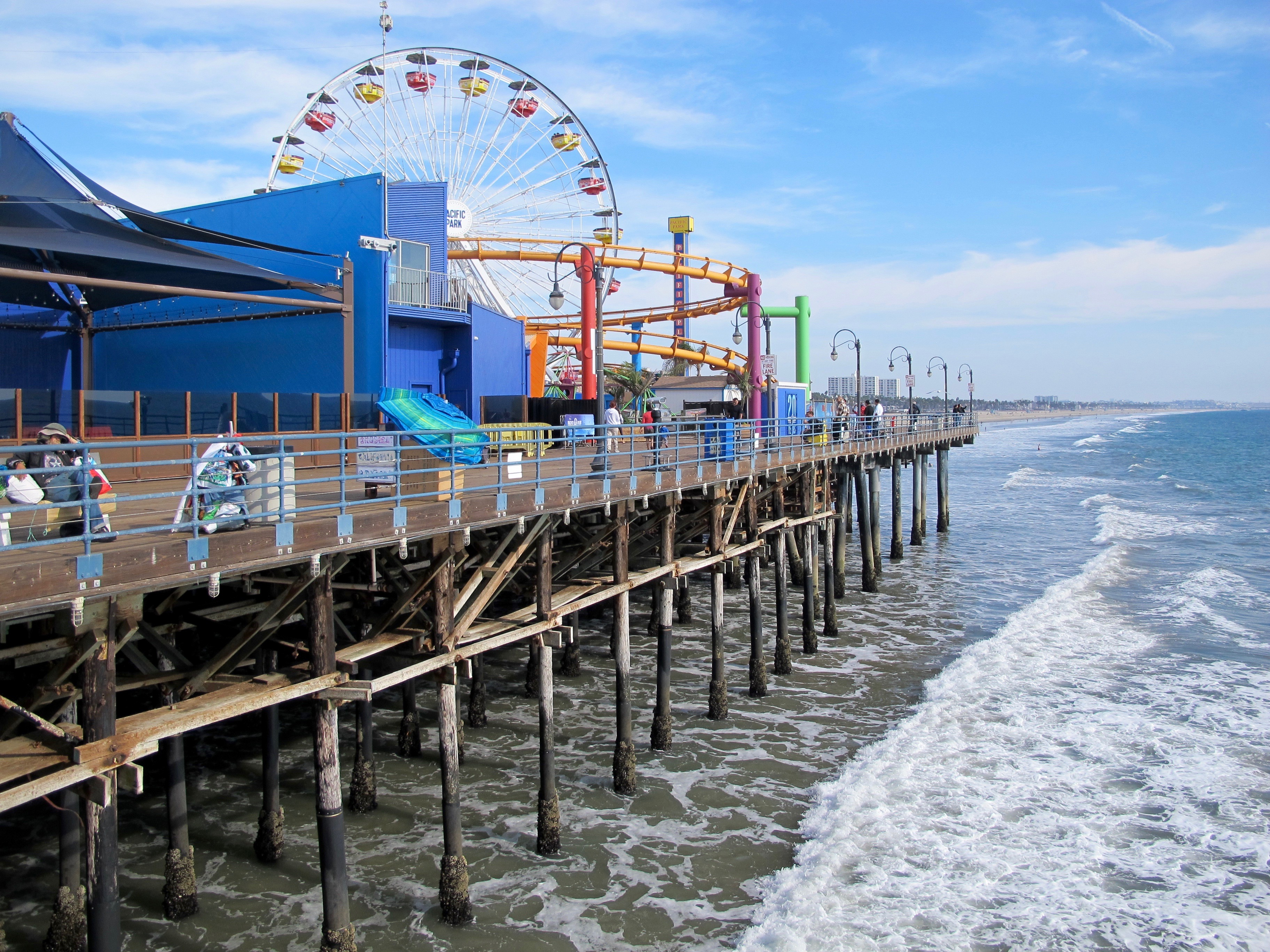 """You are looking at the historic Santa Monica Pier from the north side. This iconic landmark and the ceremonial terminus of the old Route 66 was built in 1909. The Ferris wheel is one-of-a-kind, powered by solar panels. You can also see the rails of the Blue Streak Racer, a wooden roller coaster that once belonged to the long-gone Wonderland amusement park in San Diego. Dozens of TV shows, music videos and films have been made here, including """"Titanic,"""" """"Forrest Gump,"""" """"Elmer Gantry,"""" """"Iron Man,"""" """"Grey's Anatomy,"""" """"Modern Family"""" and """"Amazing Race."""" (Photos by Laurie Brindle)"""