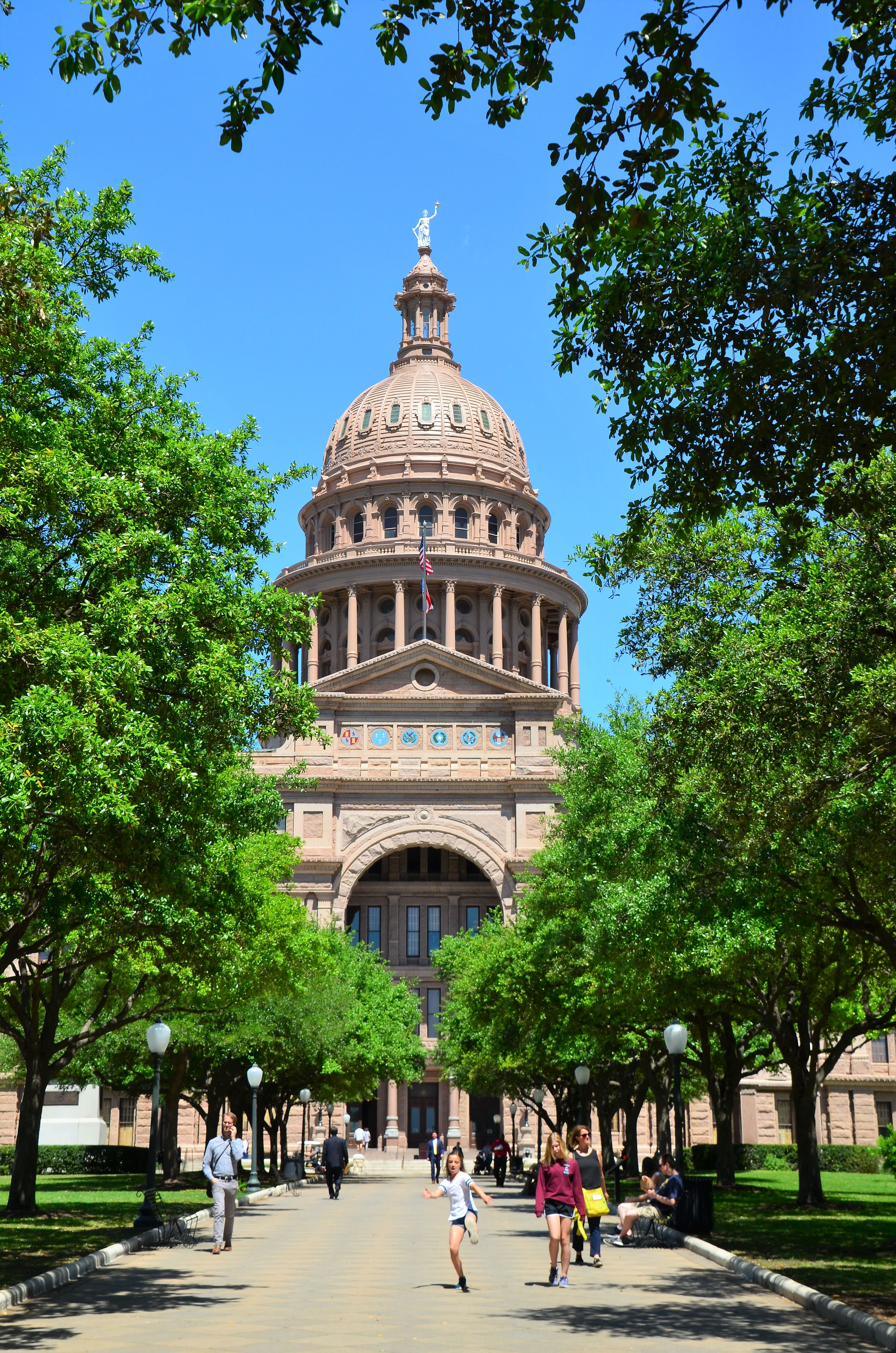An auspicious red granite exterior greets visitors to the Texas Capitol in downtown Austin. At 360,000 square feet, it is larger than any other state capitol building and the national capitol in Washington, D.C. The Texas legislature meets only every other year and for no more than 140 days. The governor may call up special sessions. (Photo by Jerry Ondash)
