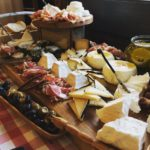 Cheese platter with a variety of different cheese and crackers