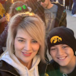 Trendi Phillips with her son who is wearing an Iowa Hawkeyes beanie