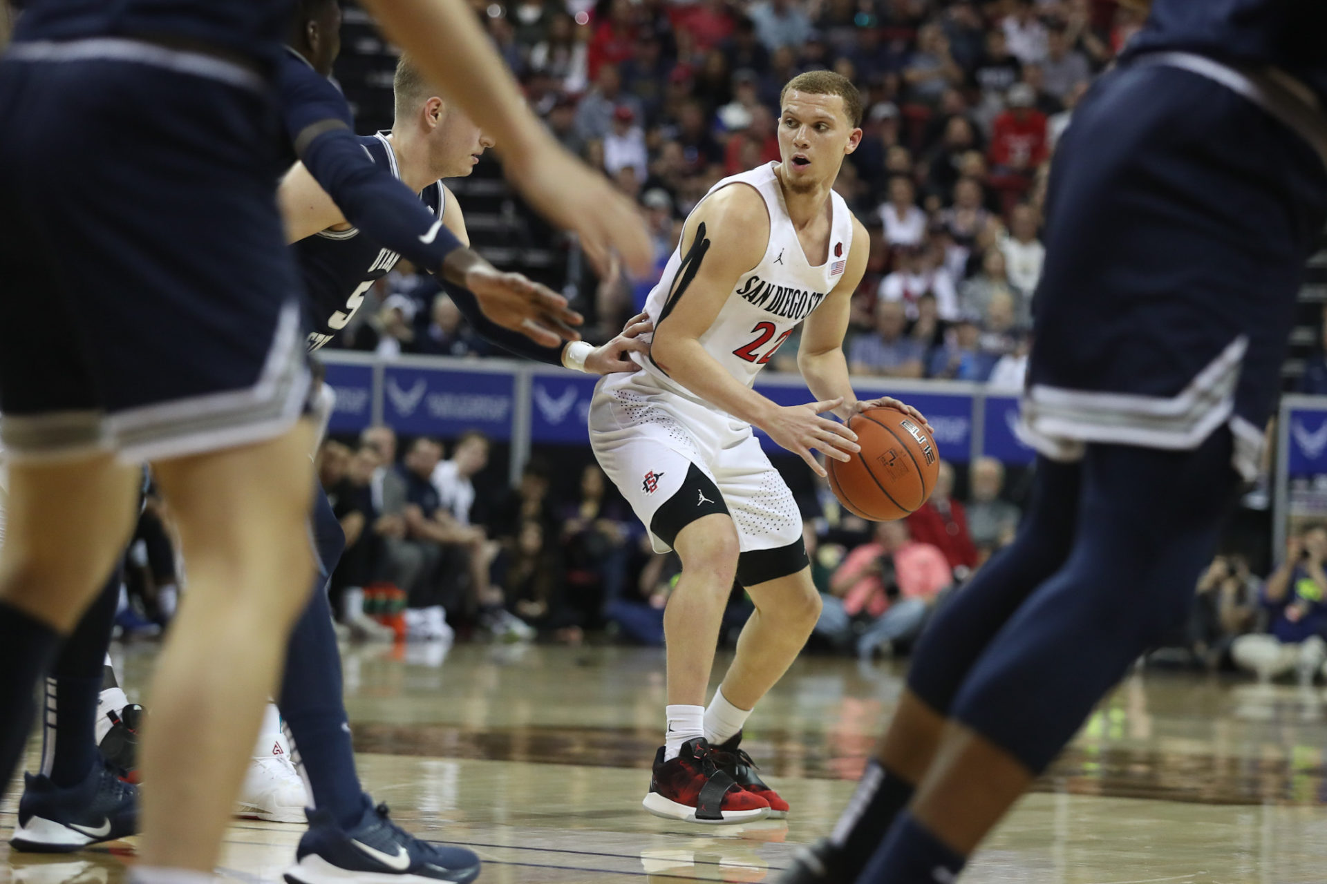 San Diego State men's basketball player Malachi Flynn dribbles the ball during a game.