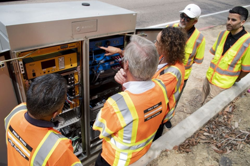 Supervisor Jim Desmond looks at a new emergency backup battery system that could keep residents safe during blackouts, emergency situations. Photo courtesy of County News Center