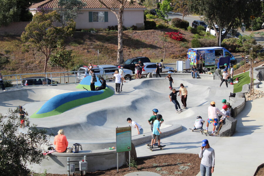 Afternoon parkgoers make use of the park's skate element. This is one of the many features that Olympus Park provides. Photo by Grant Kessler.